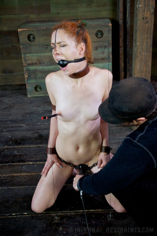 Chained subgirl is sexually teased with vibrator