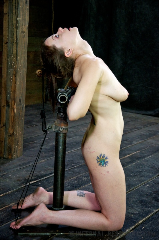 Sexy girl is put into BDSM rack and then subjected to hair-pulling