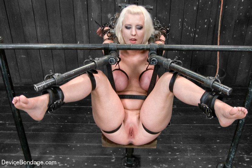 Cherry Torn is in BDSM rack suspension and her pussy is open wide for every torture possible