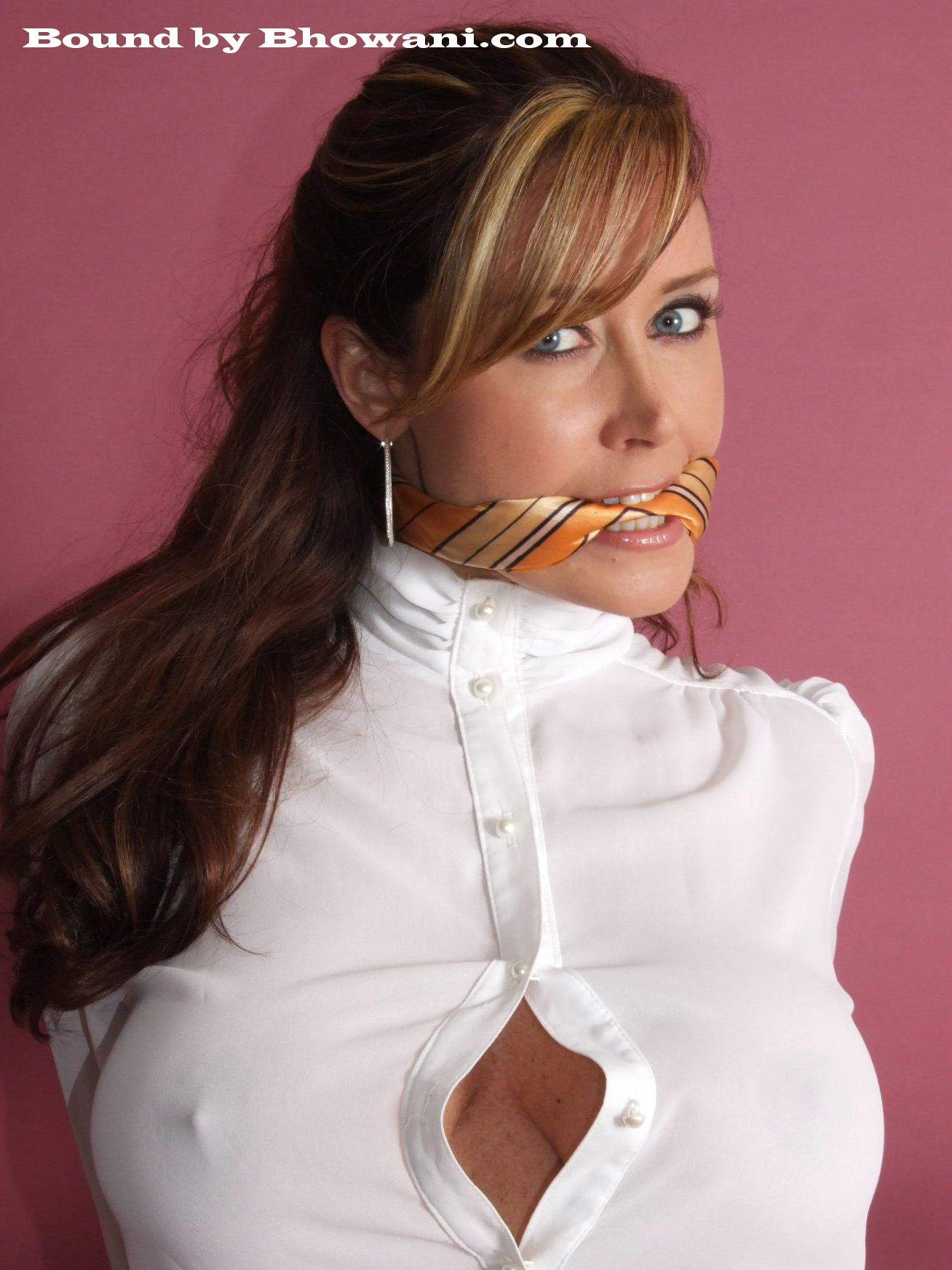 Office gal Christina Carter is gagged with silk scarf put in her mouth