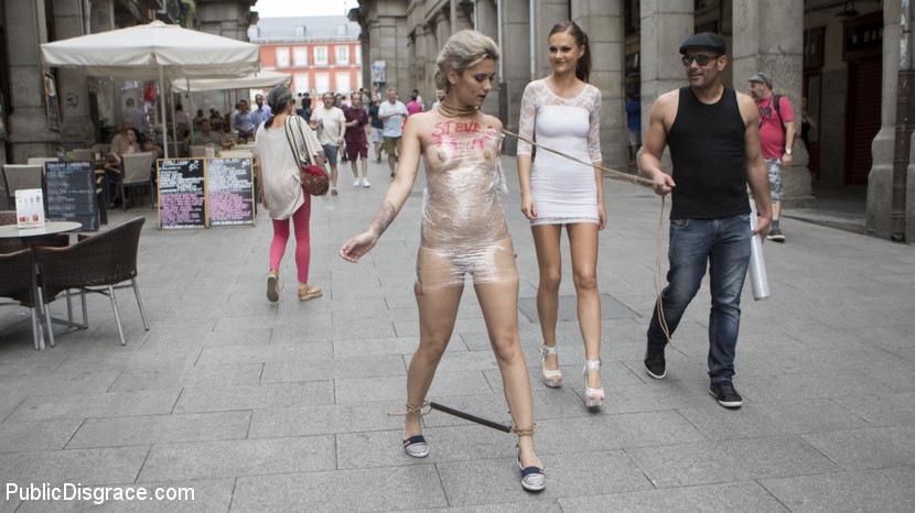 Nude girl is leashed, wrapped in plastic and dragged on a leash