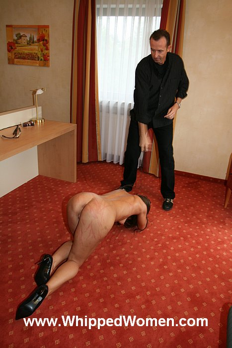 Beautiful submissive woman is on all fours and asking BDSM master to treat her withmore whipping