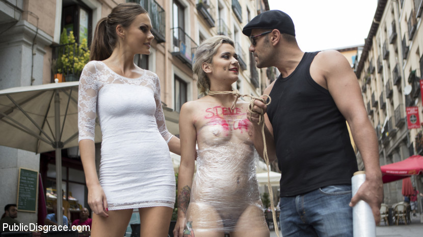 BDSM master is exposing his BDSM trainee on public: nude and leashed