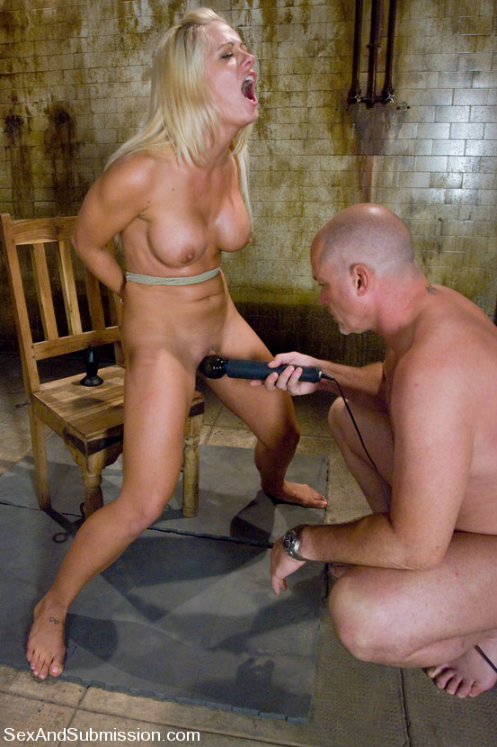 Exposed MILF is taken to the limit with her hands are tied behind the back and her pussy teased