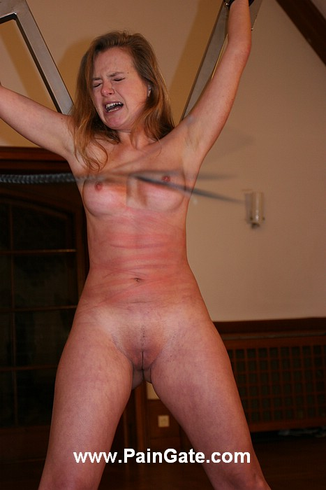 Helplessly cuffed girl is having her lovely exposed tits whipped extremely hard