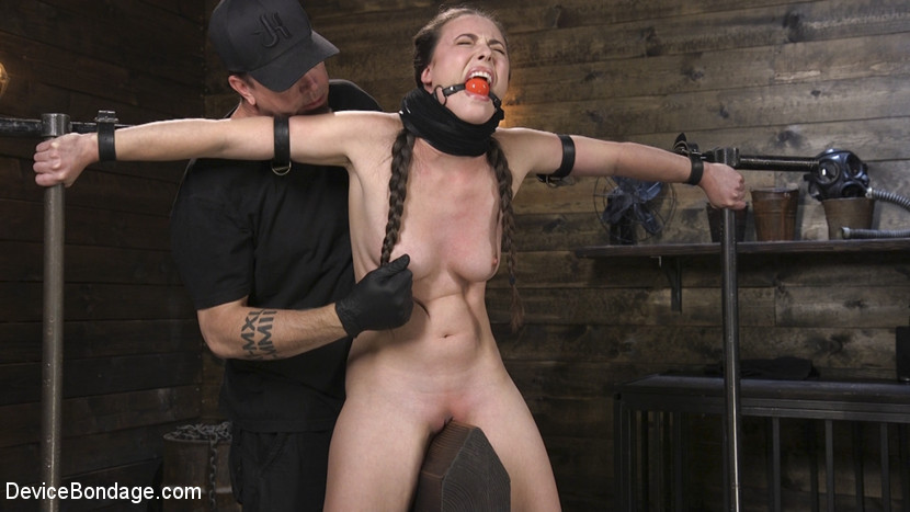 Slavegirl Casey Calvert is riding wooden pony while her nipples are twisted painfully