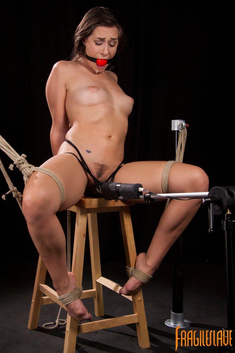 Bondage girl is gagged and cumming because of the vibrator in between her legs