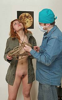 tied up and ball gagged girl is forced to ride the bdsm wooden horse