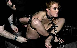 Putting naked redhead into extreme BDSM ball-tie