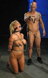 Submissive slave Phoenix Marie on her knees