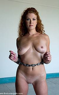 Beautiful slave Sabrina Fox posing handcuffed