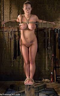 Bondage slave Trina Michaels crucified on woodel cross
