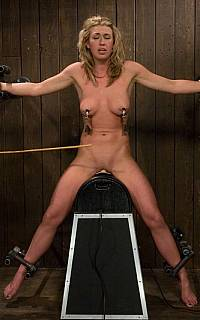 Bound female riding wooden pony