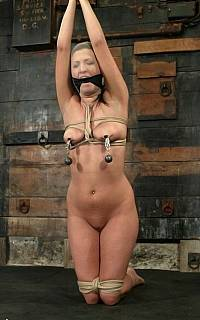 Kneeling slave with nipple clamps (Mar 2010)