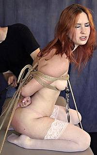 Bondage slave pleasured with nipple pain