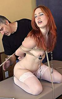 Nipple clamps and spanking punishment