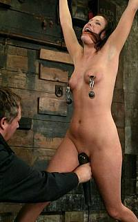 Nipple clamps slave fucked with toy (Mar 2010)