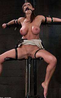 Exposed BDSM girl fucked with machine