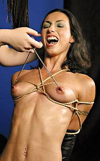 Girl in monoglove nipple tortured (May 2010)