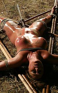 MILF captured and tied spread eagle
