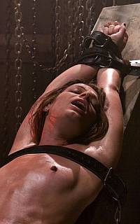 Woman bound with leather belts