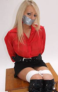 Sexy tape gagged female tied up