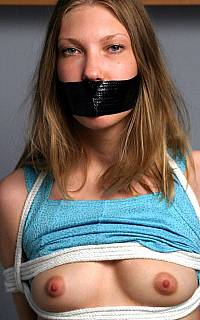 Tape gagged girl flashing her small tits