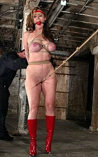 Bound gagged woman walking in high heel boots