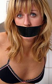 Pretty face of tape gagged blonde
