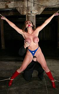 Stripped woman tied spread eagle
