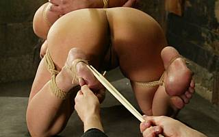 Whipping nakes asian girl with bastinado