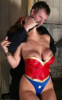 Busty superhero abducted