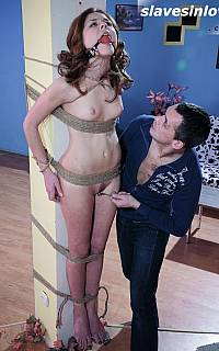 Bound gagged woman hanging on the pole