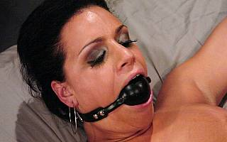 Spread eagle bondage for gagged whore