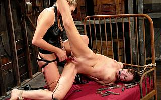 Lesbian slut is tied and fucked violently