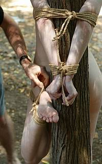 Tree tie. Undressed girl restrained outdoors (Apr 2011)
