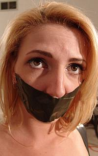 Big pretty eyes of a bondage slave