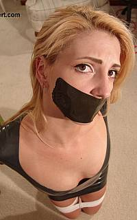 Girl mouth gagged with black duct tape