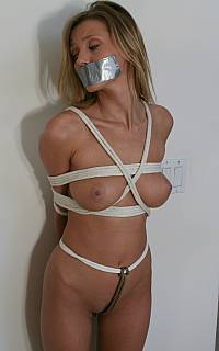 Holding to ransom tape gagged woman