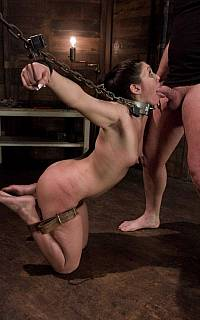 Chained girl sucks the big cock