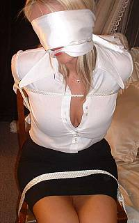 Blindfolded lady gagged with scarf