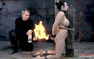 Open flames torment for BDSM slave