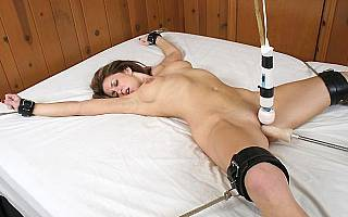 Forced orgasms of tied to bed girl