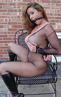 Captive girl wearing fishnets
