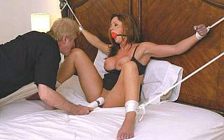 Tied spread eagle and fucked with toy