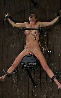 Tied spread eagle wooden pony torture