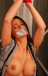 Unbuttoned blouse of a sext bondage girl