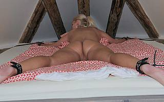 Girl with nice ass is tied to bed