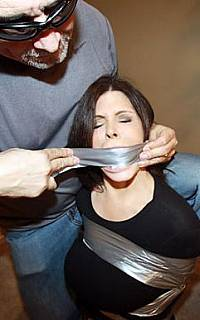 Silent tape gag for the sexy housewife