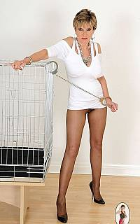 Semi-undressed and handcuffed slave Sonia